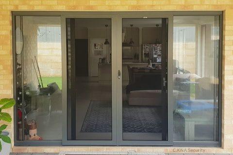 Stainless steel security door installed to Jason Glass door